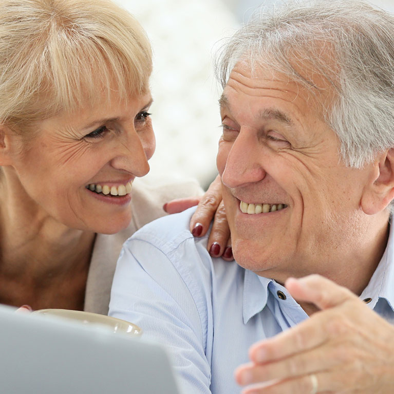 Older couple Close together smiling and laughing together