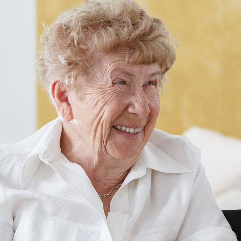 Older woman smiling looking to her left
