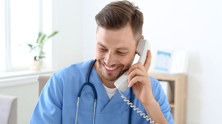 A healtcare professional talking on the phone