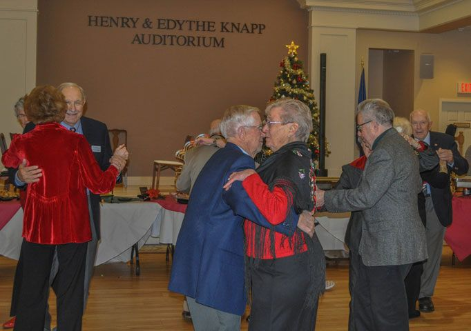 Three senior couples dancing in the Henry and Edythe Knapp Auditorium