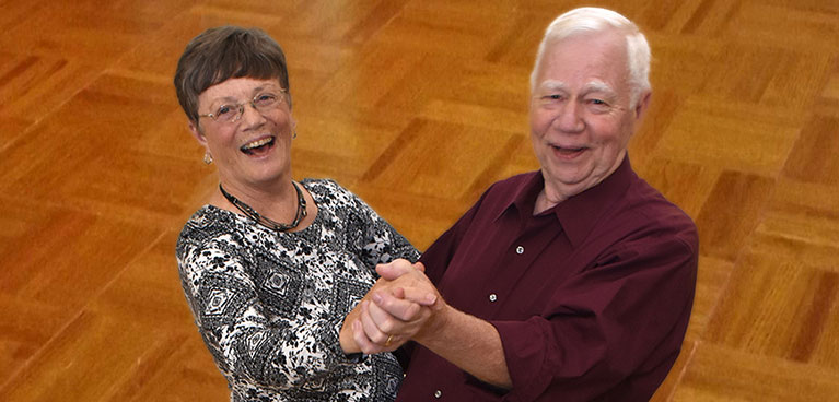 Two seniors enjoying dancing in on of Masonicare's fitness centers