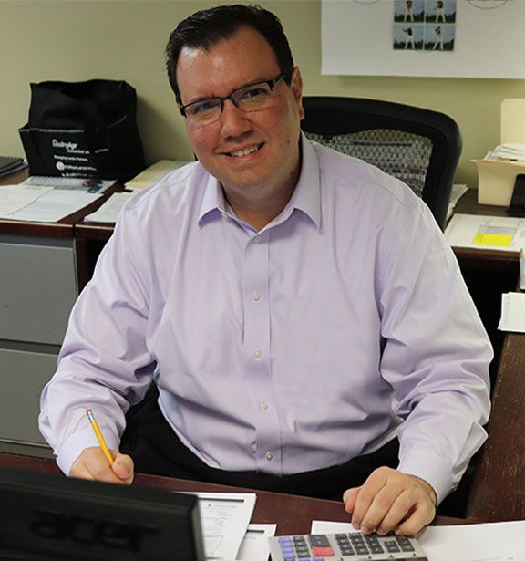 A smiling photo of Rob Leake, Corporate Director, Finance