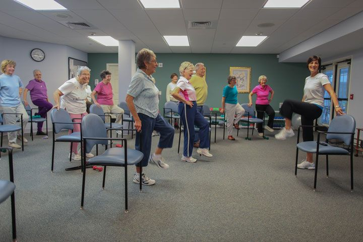 Group of senior women taking an exercising class.