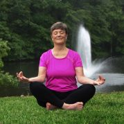 Senior woman doing yoga outside Masonicare at Mystic