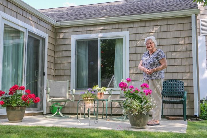 Resident enjoying the patio of her cottage.