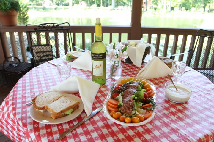 Enjoy an exquisite meal in our gazebo by the lake