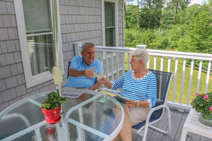 Residents toasting on their private deck