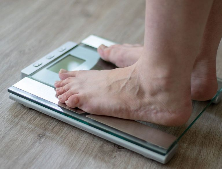 Person using digital scales for MHH